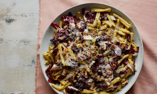 Shredded fennel, radicchio, and penne salad with bits of walnut and orange
