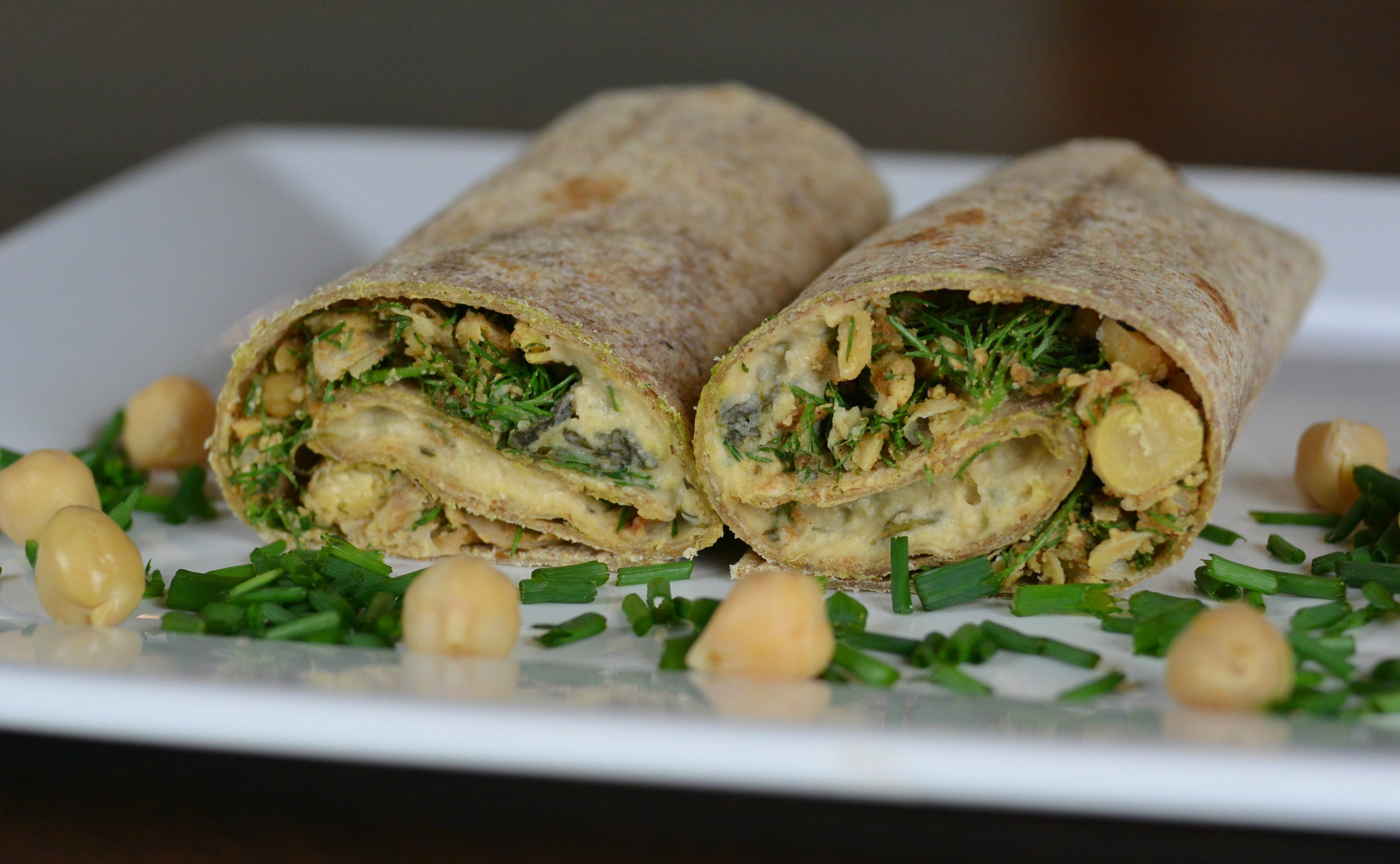 Artichoke-hummus wraps with spinach tortillas
