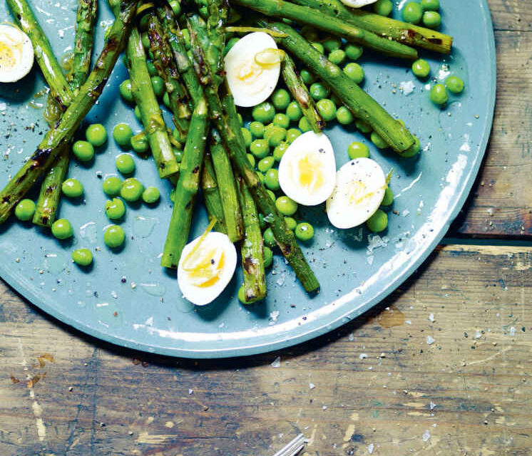 Charred asparagus and quail's eggs with peas and lime