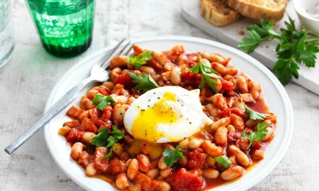 Smoky baked beans with poached eggs and chive oil