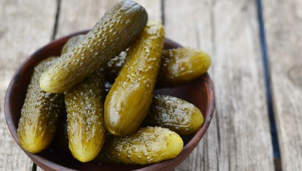 Pickled cucumbers and gherkins in horseradish vinegar