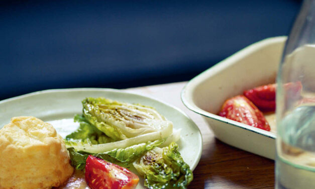 Double-baked goat's Cheddar puddings, baked tomatoes and Little Gem