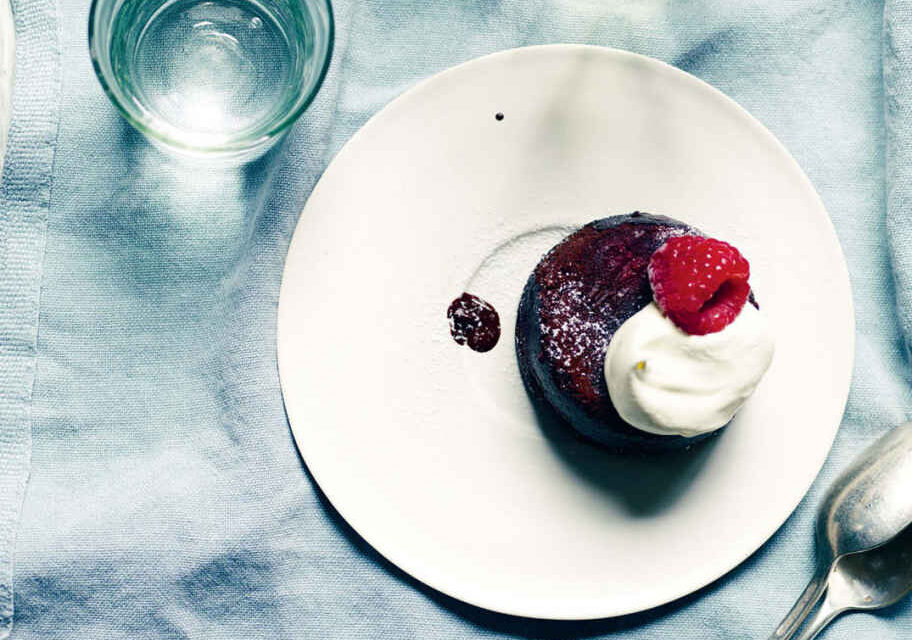 Flourless chocolate and raspberry cakes with rose cream